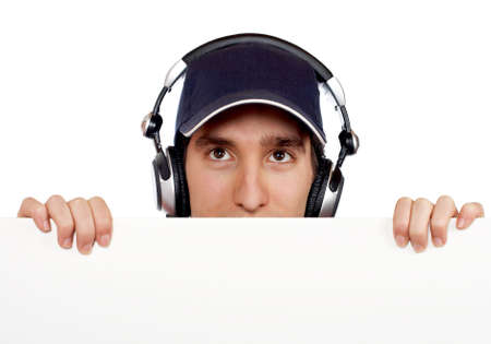 Handsome disc jockey behind the blank billboard
