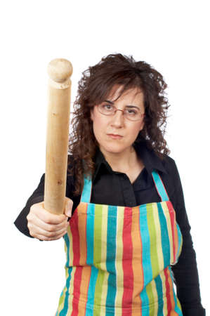 Angered housewife in apron holding a wooden rolling photo