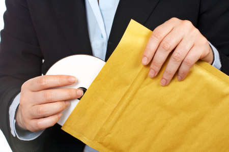 rewritable: Businesswoman put dvd disc on the envelope over a white background