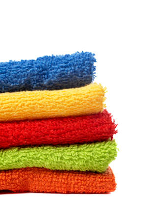 Multicolour towels stacked with soft shadow on white background Stock Photo