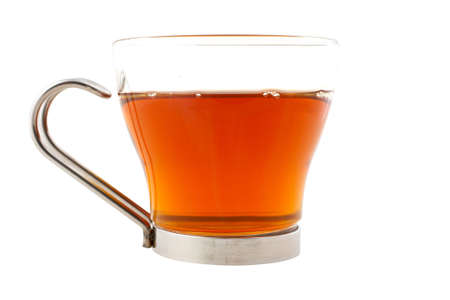 A glass cup of tea with one slice of lemon isolated, with clipping path. Shallow dof