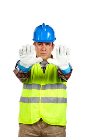 Construction worker with gloves and green vest, order to stop. Gloves on focus photo