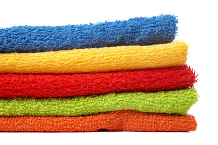Multicolour towels stacked with soft shadow on white background Banco de Imagens
