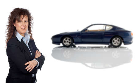 Smiling business woman who is in front of a car reflected in the bottom. Car blurred photo