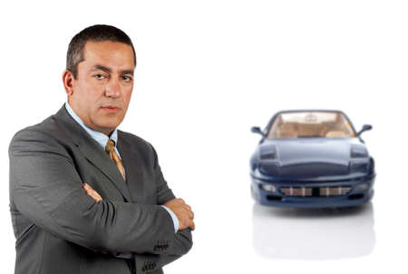 Serious CEO who is in front of a car reflected in the bottom. Car blurred