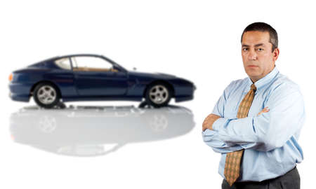 Serious businessman who is in front of a car reflected in the bottom. Car blurred