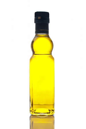Extra virgin olive oil bottle reflected on white background