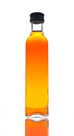 consistency: One bottle of vinegar reflected on white background Stock Photo