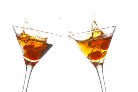 stirred: Toast with two cocktail glasses on white background Stock Photo