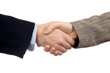 A business handshake over a white background Stock Photo