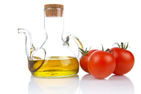 Tomatoes and extra virgin olive oil reflected on white background