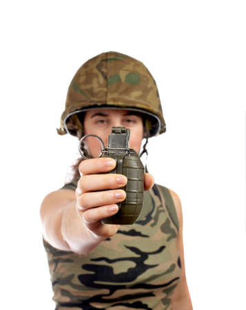 grenade: A beautiful soldier girl holding a hand grenade on white background. Focus at front and shallow DOF Stock Photo