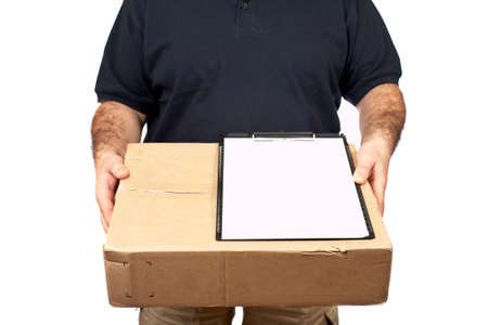 ship package: Courier delivering a package and holding a clipboard for a signature. Box on focus, shallow DOF