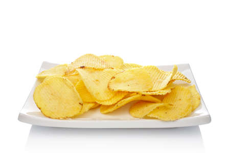 Potato chips on a dish reflected on white background
