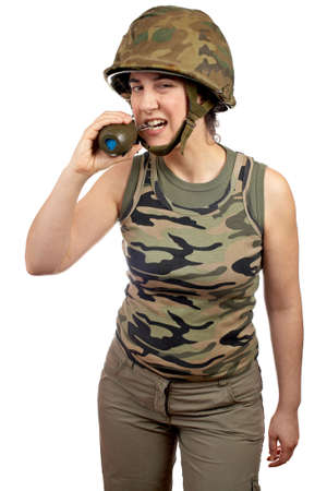 A beautiful soldier girl holding a hand grenade on white background Stock Photo - 911742