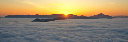 Mountains over the fog in the spring sunrise Stock Photo - 918356