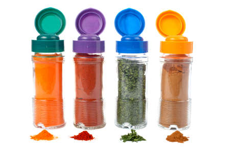 Assortment of spices jars for prepare tasty food with shadow over a white background. Shallow DOF photo