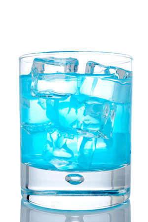 Glass of blue paradise cocktail with ice cubes reflected on white background