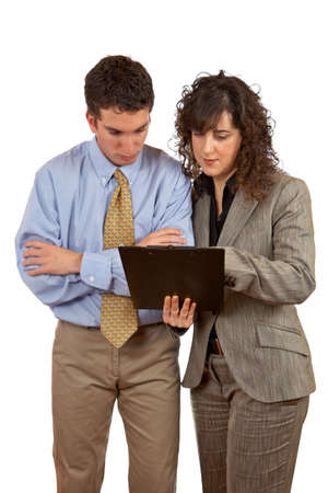 Businessman and businesswoman reading a dossier over a white background Stock Photo - 969225