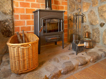 View of a cozy old fireplace in the living room Banco de Imagens