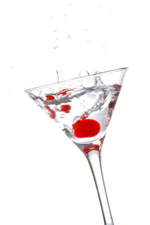 bartend: Two red cherrys splashing into a cocktail glass Stock Photo