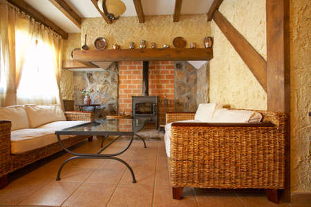 View of a cozy old living room with fireplace Banco de Imagens