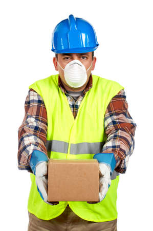 delivers: Construction worker with mask, gloves and green vest delivers a box of dangerous materials