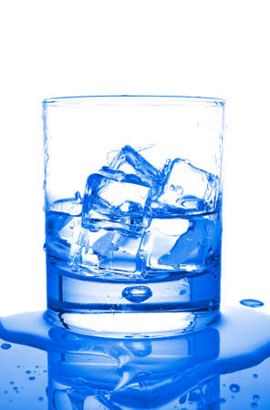 insipid: Glass of fresh liquid with ice cubes reflected on wet background