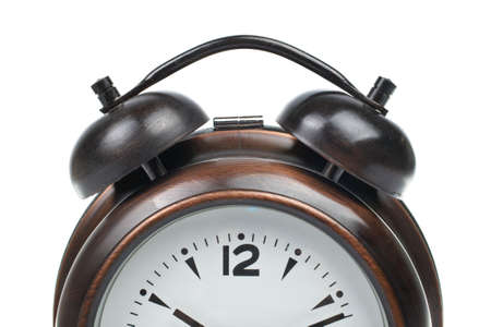 duration: Partial view of alarm clock with bells on top isolated over white background