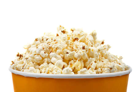 eating popcorn: Detail of popcorn in a bucket over a white background