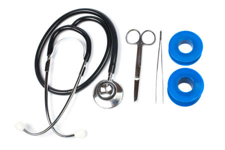 Stethoscope, medical scissors, tweezers  and adhesive bandages. Soft shadow Banco de Imagens - 1125408