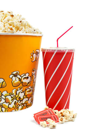 Popcorn bucket with two tickets and soda on white background photo
