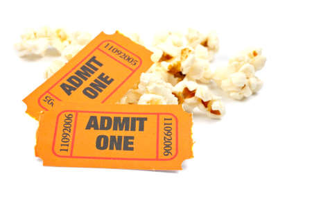 Popcorn and two tickets on white background with soft shadow. Shallow DOF Banco de Imagens - 1215823