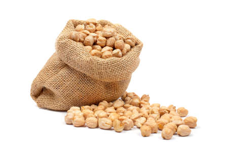 chickpeas: Burlap sack with chickpeas spilling out over a white background. Soft shadow Stock Photo