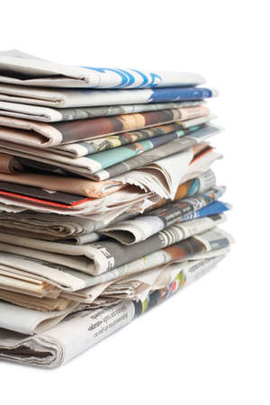 A stack of local newspapers with focus on front. Shallow DOF Banco de Imagens - 1230035