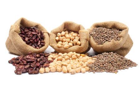 kidney beans: Lentils, chickpeas and red beans spilling out over a white background. Stock Photo