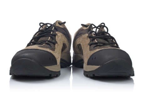 A pair of hiking boots with shadow reflected on white background photo