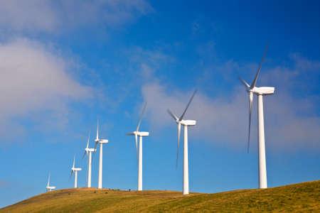 watts: Wind turbines farm on sunset in summer