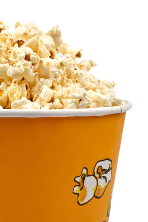 edibles: Detail of popcorn in a bucket over a white background