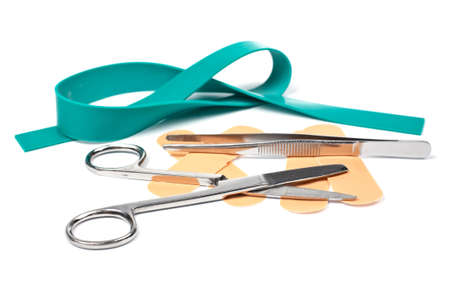 tweezers: Medical scissors, elastic rubber, tweezers  and adhesive bandages. Shallow DOF Stock Photo