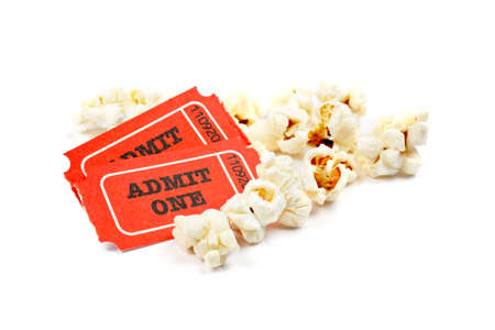 edibles: Popcorn and two tickets on white background with soft shadow. Shallow DOF