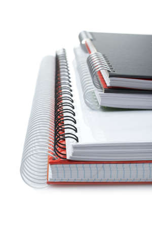 Some notebooks with soft shadow on white background. Shallow DOF photo