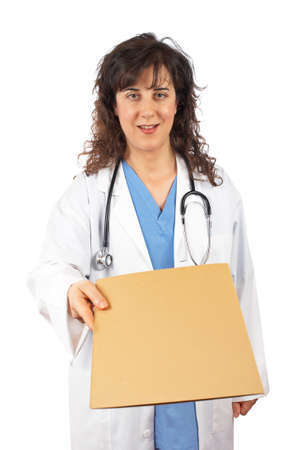 Friendly female doctor in lab coat, handing a dossier over a white background photo