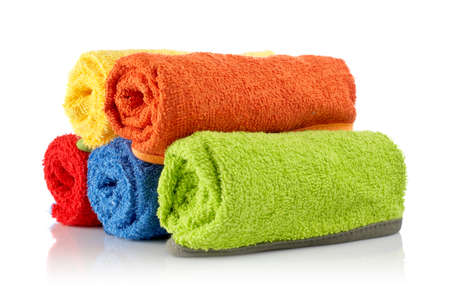 absorbent: Multicolour towels rolls reflected on white background Stock Photo