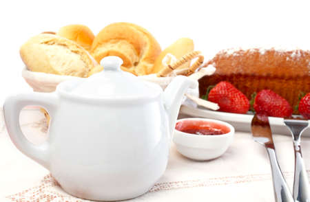 Fork, knife, strawberries, raspberries, slices of bread, sugar cubes and jam for healthy breakfast. Shallow DOF photo