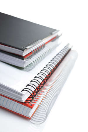 Some notebooks with soft shadow on white background. Shallow DOF Stock Photo - 1544664
