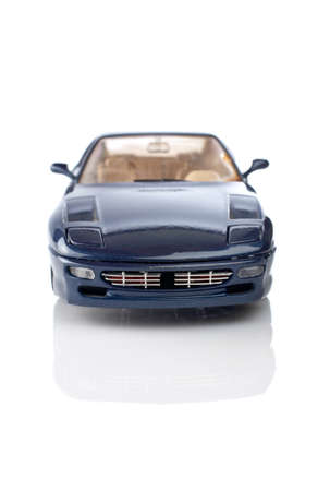 Blue car reflected on the white background. Focus at front and shallow DOF Stock Photo - 1592263