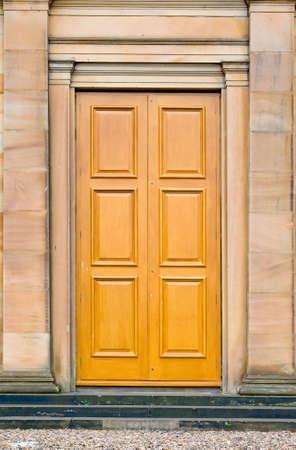 Antique castle door between columns of stone Stock Photo - 1807325