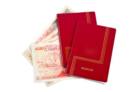 foreign nation: Two passports and money isolated on white background.  Stock Photo