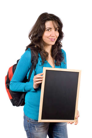 Young student woman with a backpack and holding the chalkboard on white background photo